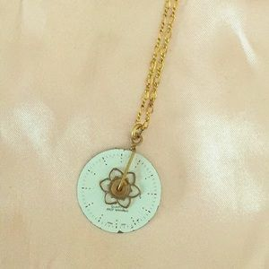 Anthropologie white and gold steampunk necklace.